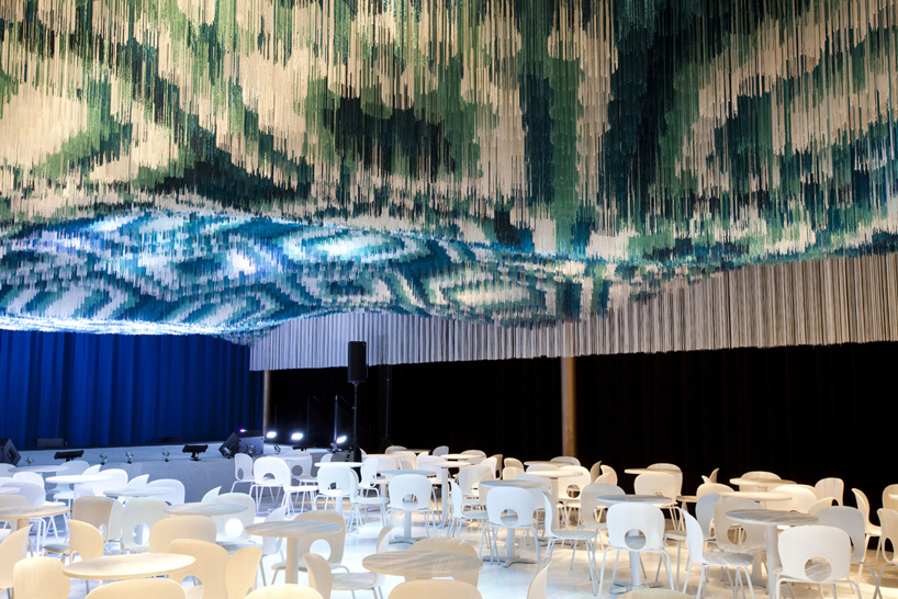 Architects Install Suspended Indian Carpet Inside The